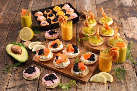 assorted of finger food, buffet food with verrine and canape- festive table