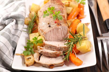 raw veal or pork fillet with potato, carrot and garlic Stock Photo