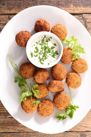 falafel with dipping sauce and herb