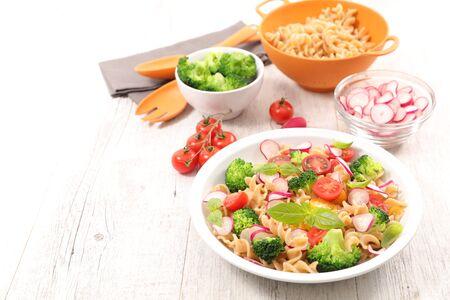 pasta salad with broccoli, radish and basil Фото со стока