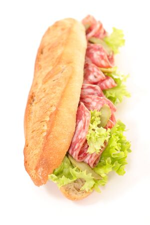 baguette with salami and lettuce isolated on white background