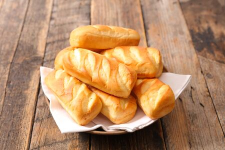 bread, bun bread on wood background Фото со стока