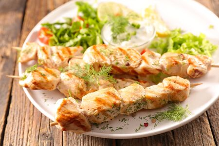 fried chicken skewer with salad and sauce