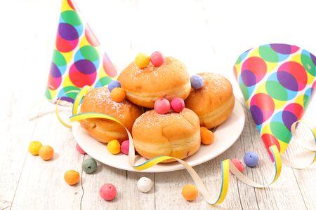 gourmet donut and carnival decoration Фото со стока