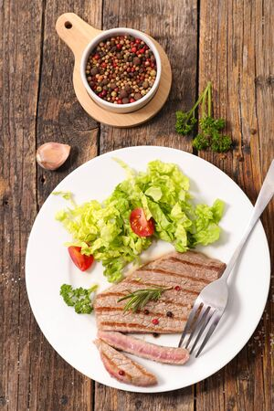 grilled beefsteak with salad and tomato