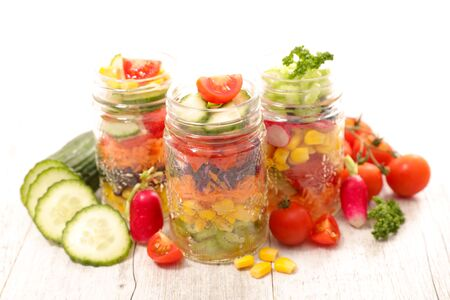 fresh vegetable salad with tomato, cucumber, radish, carrot Фото со стока