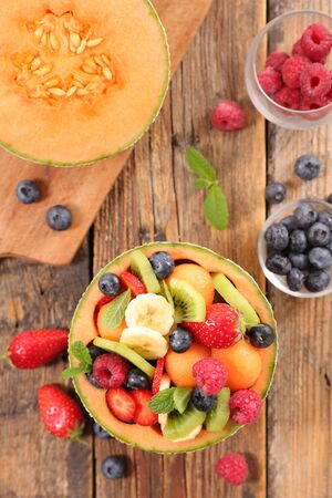 fresh fruit salad with banana, melon and berry