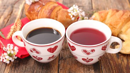 coffee cup and tea cup with croissant- february 14th