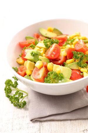 bowl of tomato, avocado and corn salad