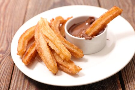 fried churros and chocolate sauce