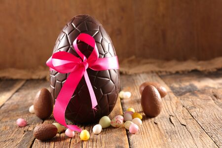 chocolate easter egg on wood background