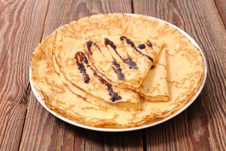 delicious crepe with chocolate sauce Фото со стока