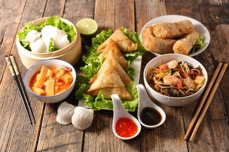 assorted of asian food, spring roll- samossa- dim sum- fried noodles Stock Photo - 137560788