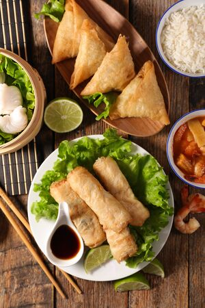 assorted of asian food, spring roll- samossa- dim sum- fried noodles Stock Photo