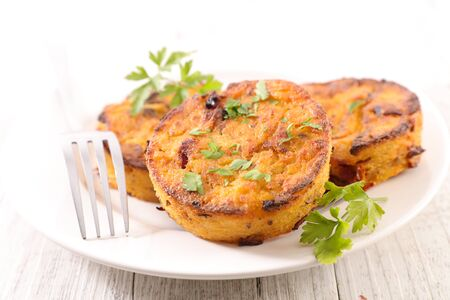 fried polenta with parsley in plate