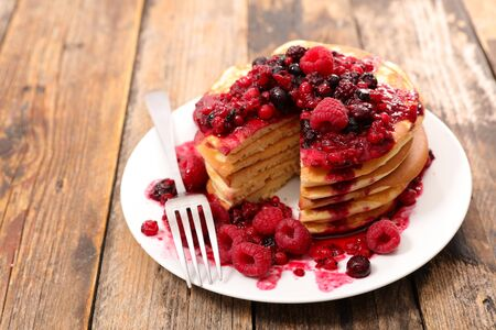 stack of pancakes and berries fruits syrup Banco de Imagens