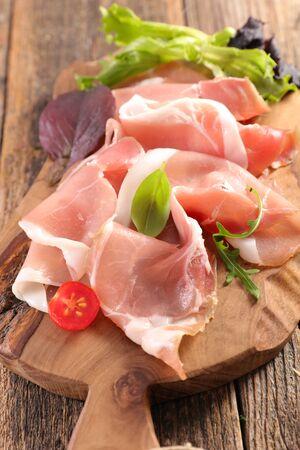 prosciutto ham on wooden board