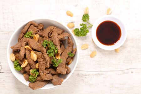 fried beef, spice and nuts with noodles- asian dish