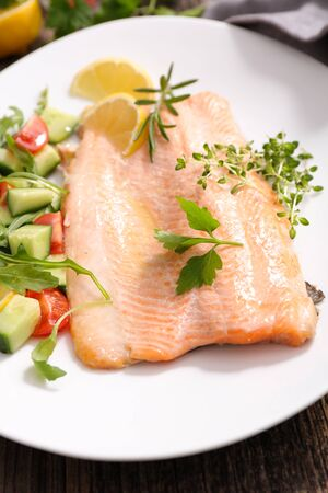 salmon fillet with vegetable on plate