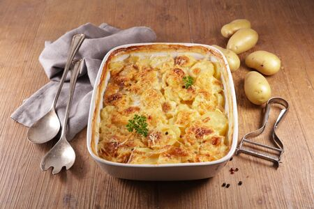 baked potato with cheese and cream- gratin dauphinois, french dish Stock Photo