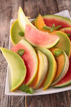 melon, watermelon slices and mint
