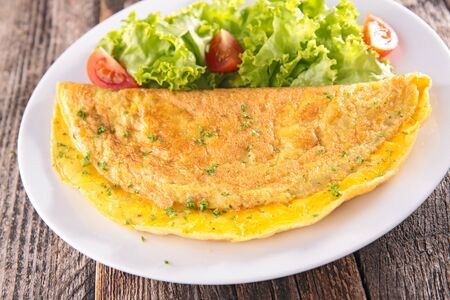omelet and salad in plate