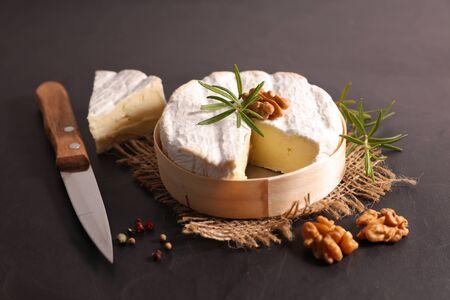 camembert with rosemary and walnut Фото со стока