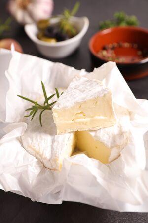 camembert slice and rosemary,olives Фото со стока