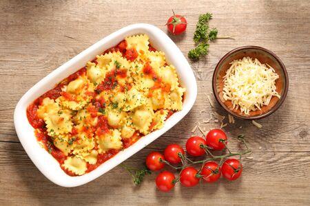 ravioli with tomato sauce and gruyere Фото со стока