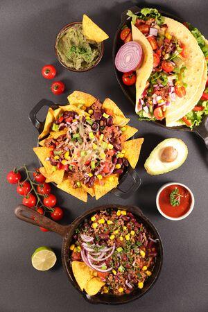 assorted of mexican dishes- fajita, nachos, chili con carne
