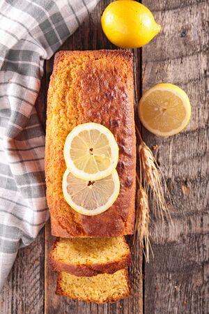 lemon pound cake on wood background