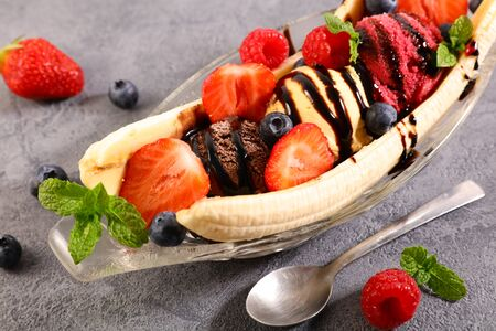 banana split- ice cream with chocolate sauce and strawberry