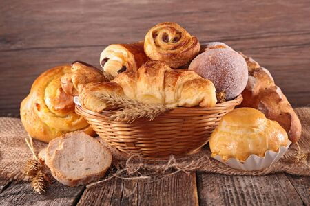 assorted of pastry and croissant on wood background