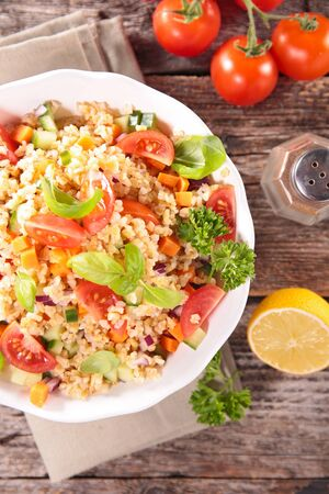 quinoa salad with tomato, bell pepper and basil