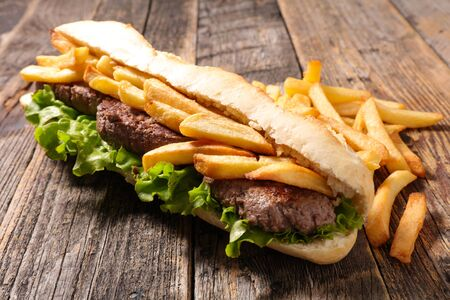 american sandwich- baguett with beef steak and french fries Standard-Bild