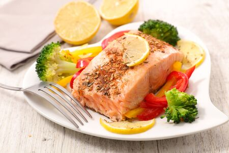 baked salmon fillet with vegetable in plate