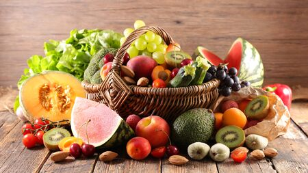 fruit and vegetable with wicker basket Foto de archivo