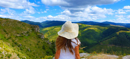 woman looking at beautiful landscape- Cevennes, Lozere, Gorges de la Jonte, Causse Mejean