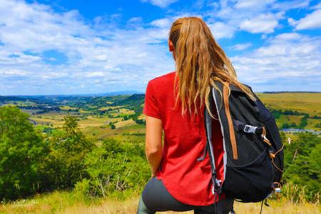 woman backpacker enjoying beautiful countryside France Stock Photo
