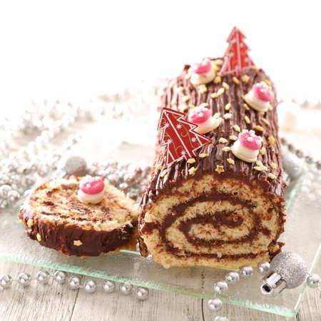 chocolate yule log christmas cake- chocolate swiss roll and festive decoration