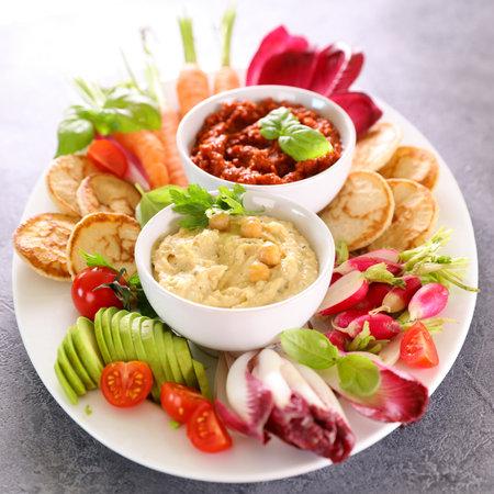 vegetable snacks plate, vegetables and dips- health food