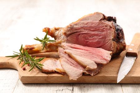 sliced lamb chop on wooden board