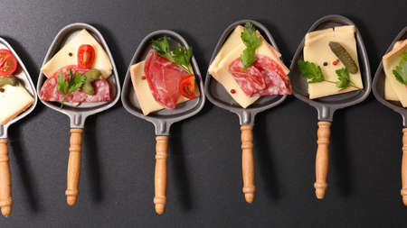 raclette cheese party- top view 版權商用圖片
