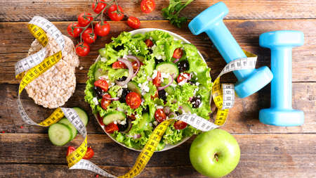 diet food concept with salad, dumbbell and meter measure 版權商用圖片