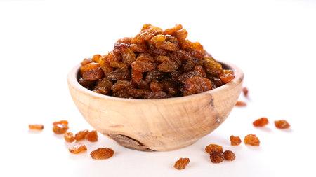 bowl of raisin on white background