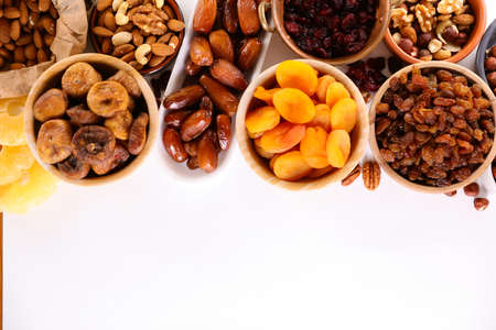 selection of dried fruit on white background
