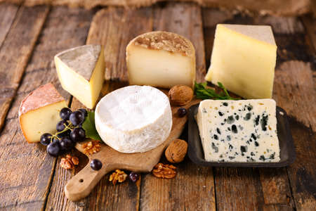assorted of dairy product on wood background