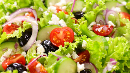 vegetable salad with tomato, olive, onion and cheese