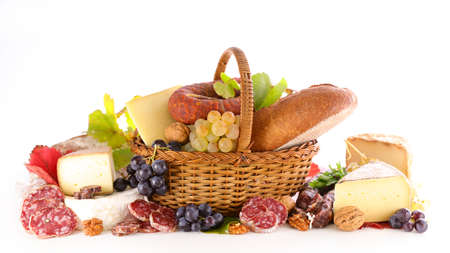 wicker basket with bread, cheese and salami