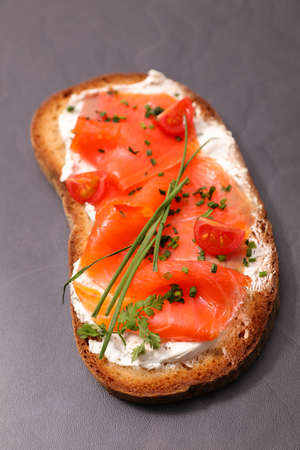 bread slice with smoked salmon and cream